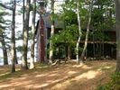 View of the house with the lake just beyond. - Acton lodge vacation rental photo