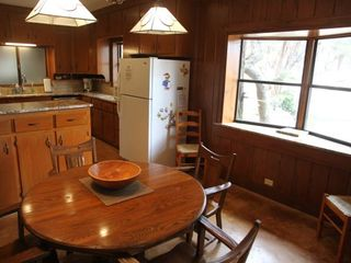 Breakfast table and kitchen. - Wimberley house vacation rental photo