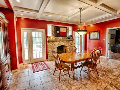 Kitchen dining area with fireplace.