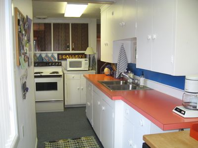 Another view of kitchen shows oven, dishwasher, micro, coffeemaker etc.