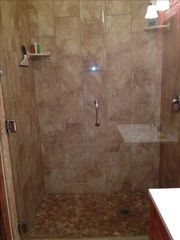 Paso Robles barn photo - Extra large limestone shower in Western Guest Cottage