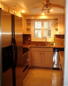 Fully updated kitchen with granite counters and new stainless steel appliances.