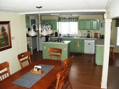 Bright kitchen is open to the living and dining rooms.