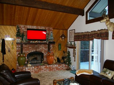 Cozy fireplace & 50 inch flatpanel HDTV with satellite & Blueray player
