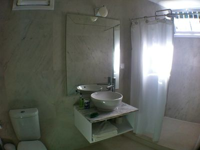 Elegant newly fitted Bathroom with walk in shower