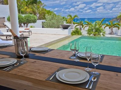 Champagne pool dining table ocean view