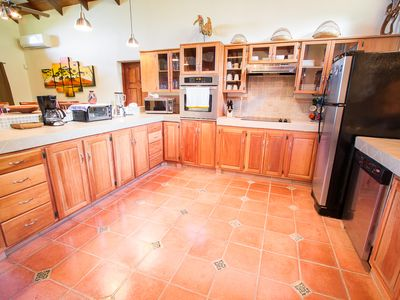 Kitchen - spacious and ample and fully supplied to make your stay delicious.