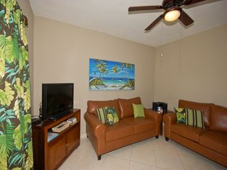Playacar condo photo - Comfortable living area for watching TV or reading a book.