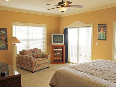 Comfortable seating area in the master bedroom, cable TV and DVD/ Gulf view