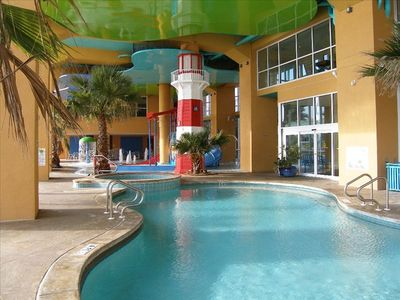 "Lazy River Pool w/ ""Dive-In Movie Theater"" showing movies at night"