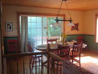 Saint-Sauveur cabin photo - Sunny dining room looks out onto lake. Deck and BarBQ just outside