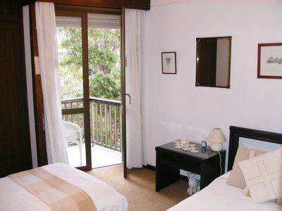 Twin bedroom- with door to small balcony