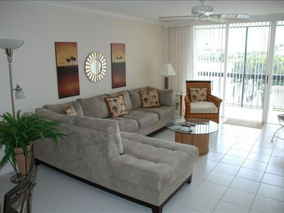 Main living room area - professionally decorated, overlooks Bay (east exposure).