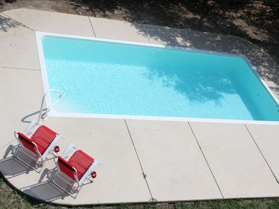 Private pool with 4 antigravity lounge chairs and muliple small tables