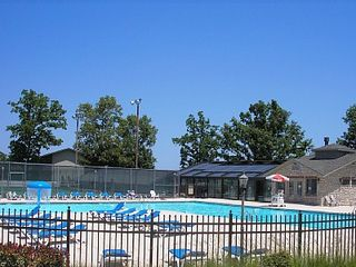 Branson condo photo - Pool, hot tub, tennis courts beyond the back fence and indoor pool.