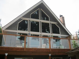 Camano Island house photo - Lots of windows facing towards the water and the mountains.