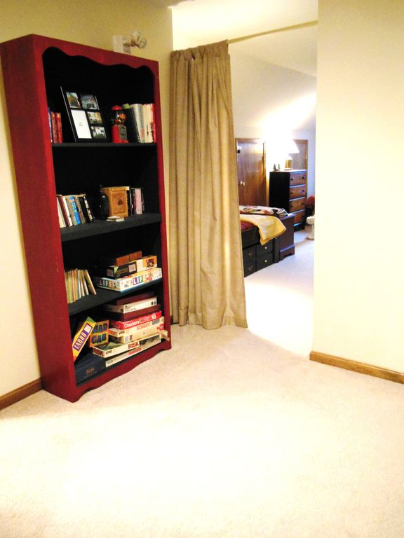 Upstairs landing leading to loft (games and books in bookshelf)