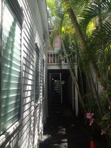 Coral colored door is the upstairs entrance to Southernmost Kellers.