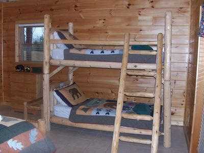 Bunk bed in large bedroom also has a queen size bed and private deck to hot tub!