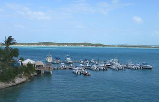 Great Exuma villa photo - View of February Point Marina and Bistro from the back porch of villa.