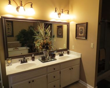 You will find plenty of space in the master bath.