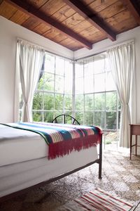 West Bedroom with Floor to Ceiling Casement Windows