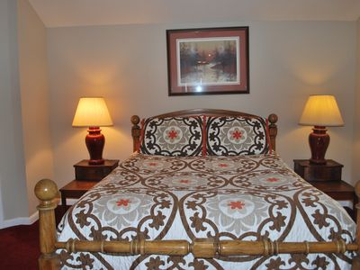 The SECOND BEDROOM with queen sized pillow top mattress and private 1/2 bath