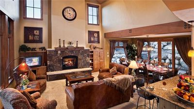 Open Living Room with Fireplace and Flat Screen TV