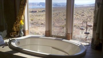 Oversized Bath Tub in Master Suite with view of Lake