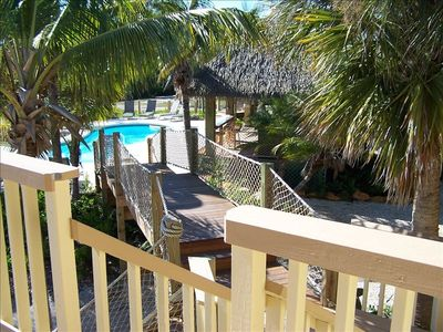 Walkway from the home to the pool and tiki bar.