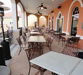 Regal Palms townhome photo - Outdoor dining overlooking the pools