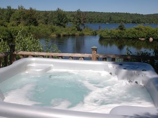 hot tub in summer - Colton cottage vacation rental photo