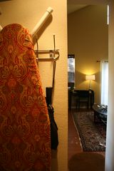 An iron, ironing board, starch and a lint roller are standard. Umbrellas too. - Austin studio vacation rental photo