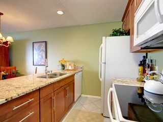 Kailua Kona condo photo - Newly Remodeled Kitchen with Granite Counters, Full Size Washer/Dryer in Closet