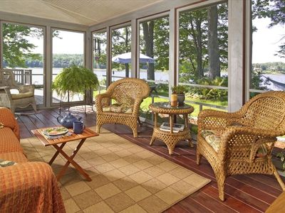 Relax at the water's edge in this wonderful screened porch!