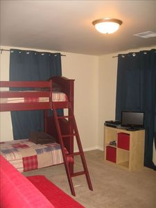 Kids Room with Bunk Beds and Plush Pull out Queen Sized Futon