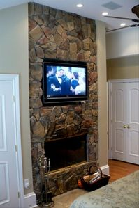Master bedroom wood burning fireplace & 50' TV