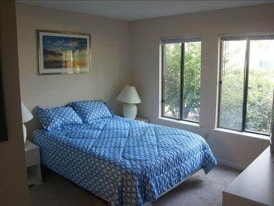 Master bedroom with private full bath and tennis court view