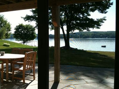 View of the patio and lake from the downstairs master bedroom slider