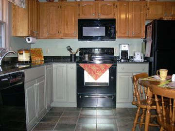 The granite counter tops provide beauty and function.