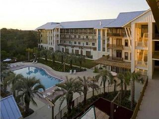 Santa Rosa Beach condo photo - View of the pool and back of village from an upper floor