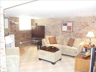 Woodley Park apartment photo - The living room space with accented brick wall.