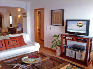 Puerto Vallarta condo photo - Three TV's with English and Spanish cable TV stations and FREE WiFi
