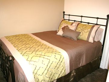 Second bedroom queen bed with a Serta pillow top mattress-it's heavenly! :)