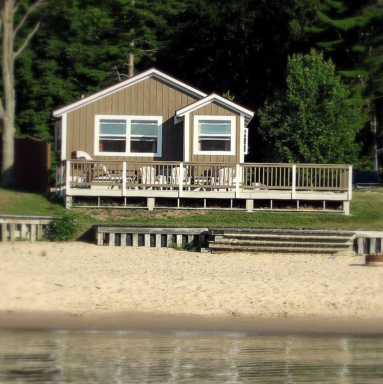 Tawas cabin rental - Front of cabin from the water. Renters enjoy a private beach.