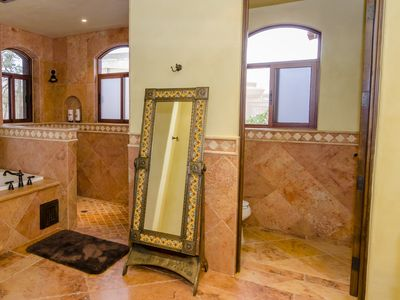 Stone tiled third bathroom