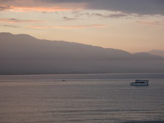 Maalaea condo photo - Sunrise and whale watch boat from our lanai. Look close for the whale!