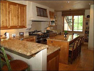 Snowmass Village house photo - Gourmet kitchen with additional seating for 7