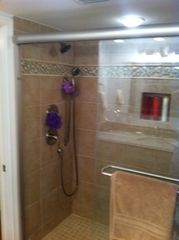 downstairs master bath has luxury shower with dual shower heads - Indian Shores condo vacation rental photo