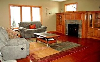 Prior Lake house photo - Liviing room includes gas fireplace & lots of room & view.